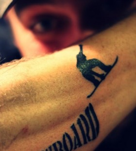 Arm's black skiing tattoo
