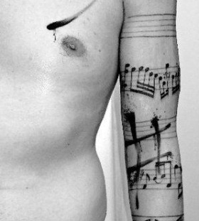 Awesome hand and shoulder music style tattoo