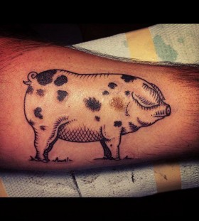 Black dots pig tattoo