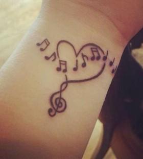 Black heart music style tattoo