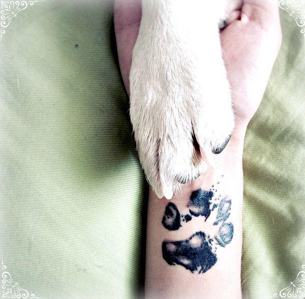 Black paw dog tattoo