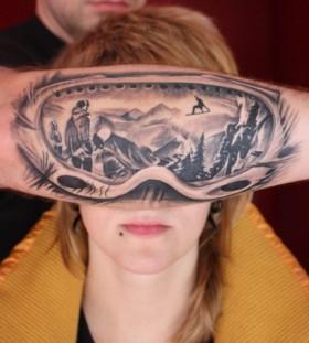 Classic women's and men's skiing tattoo