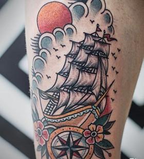 Clouds and sun ship tattoo