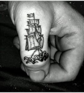 Cool finger ship tattoo