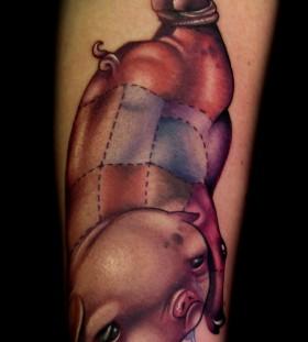 Cruel looking pig tattoo