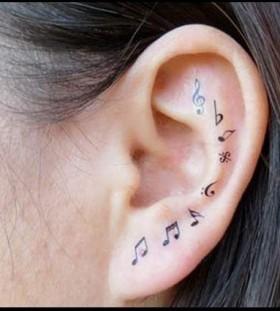 Cute ear music style tattoo