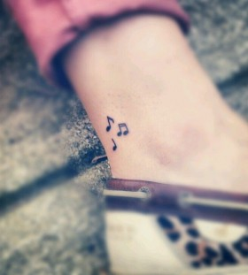 Cute looking music style tattoo