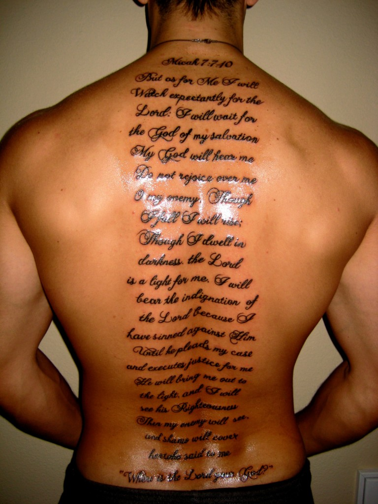 English scripts men 39 s back tattoo tattoomagz for Simple back tattoos for guys