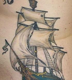 Flag and black skull ship tattoo