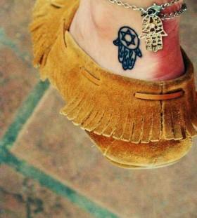 Foot small black hamsa tattoo