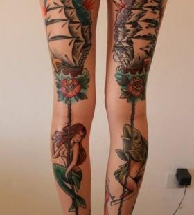 Girl's leg's ship tattoo