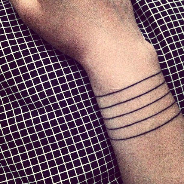 Simple line's lines tattoo - TattooMagz