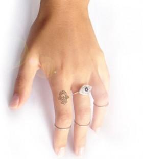 Small finger hamsa tattoo