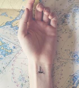 Small wrist ship tattoo