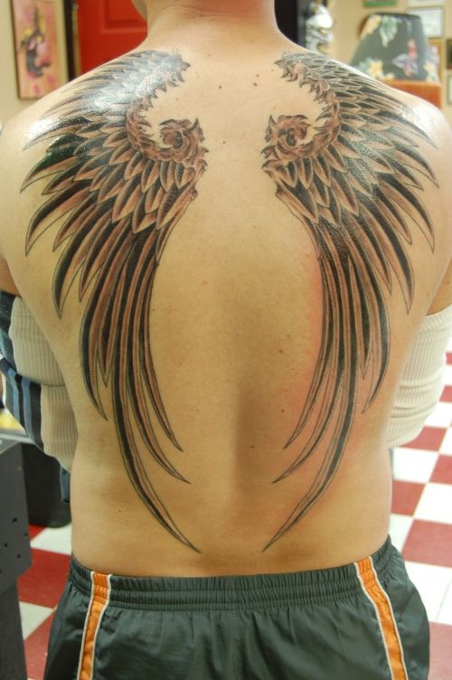 Wings simple men 39 s back tattoo tattoomagz for Simple back tattoos for guys