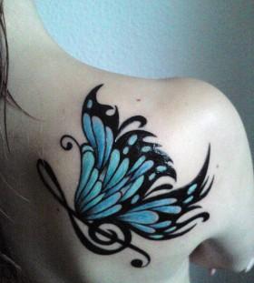 Black music style blue back tattoo