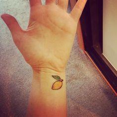 Awesome lemon tattoo on wrist