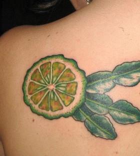 Lemon tattoo on back