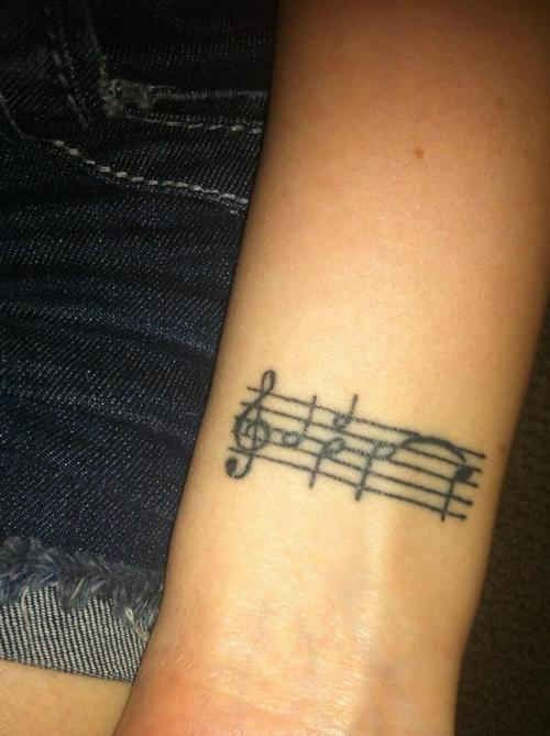 black simple music note tattoo tattoomagz