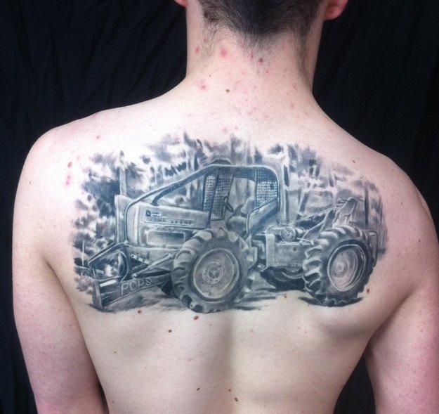 Simple tractor tattoo on leg - TattooMagz