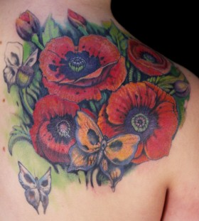 Colourful poppy flower and butterfly tattoo