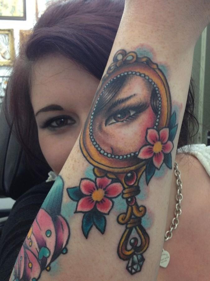 Girl's eye in the mirror tattoo