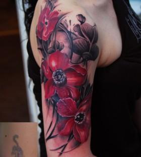 Great poppy flower arm tattoo