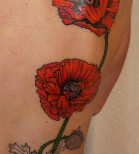 Poppy flower back tattoo