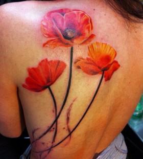 Realistic poppy flower back tattoo
