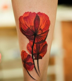 Simple poppy flower leg tattoo