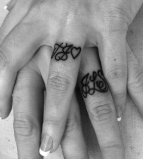Small fingers husband and wife tattoo