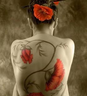 Stunning poppy flower back tatttoo