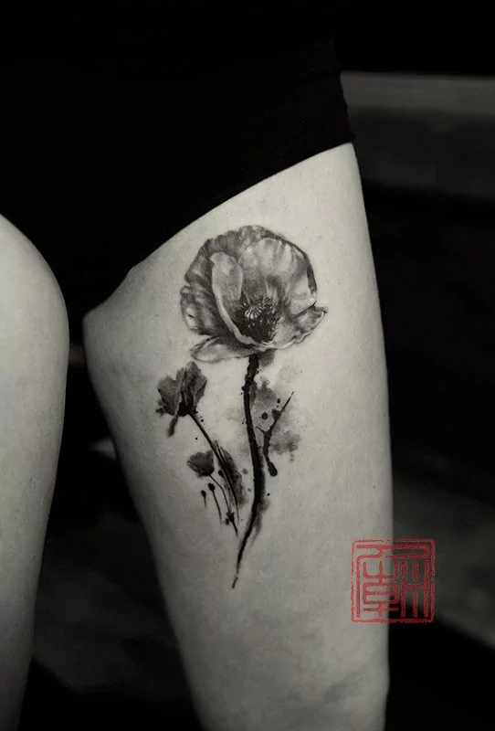 thigh poppy tattoo