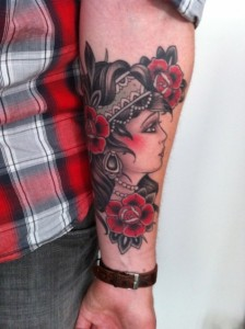 Woman and roses tattoo by W. T. Norbert