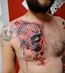 Xoil skull tattoo on chest