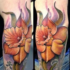 Yellow flower tattoo by Jon Mesa