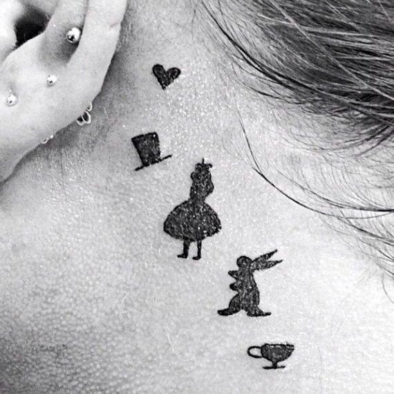 alica in wonderland tattoos for women