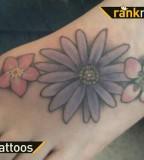 Beautiful Aster Flower Tattoo Design on Foot