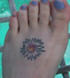 Cute Tiny Aster Flower Tattoo Design on Foot