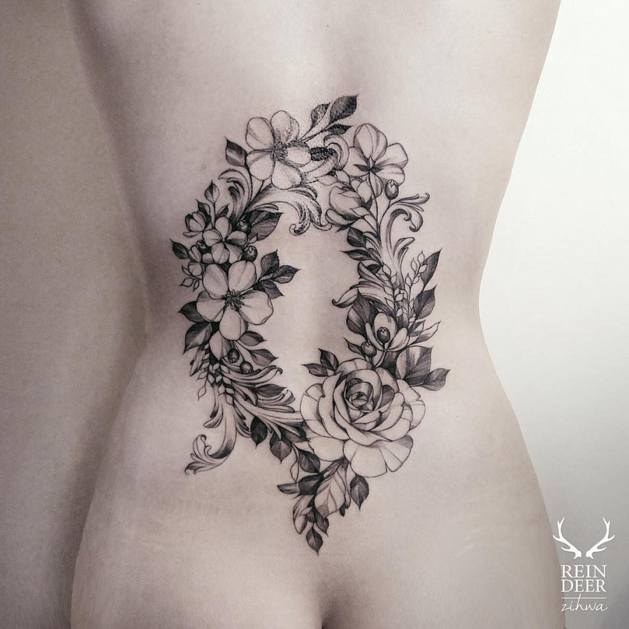 beautiful-back-piece-flower-tattoo