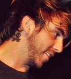 Skull Behind Alexs Ear Tattoo