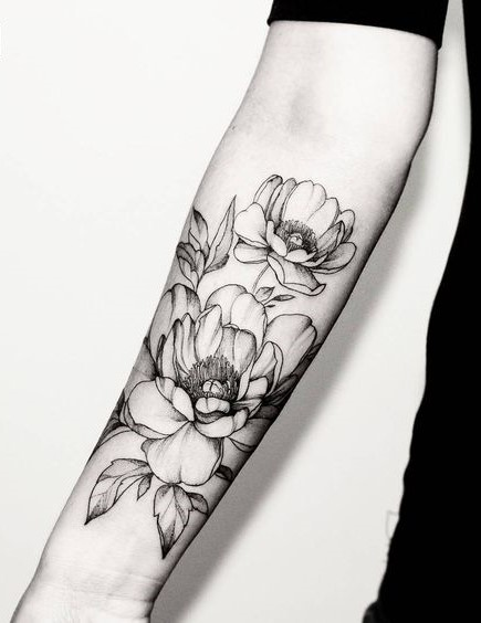 blackwork flower tattoo
