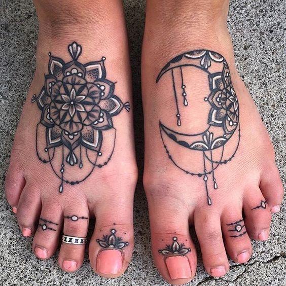 blakc and white foot mandala tattoo