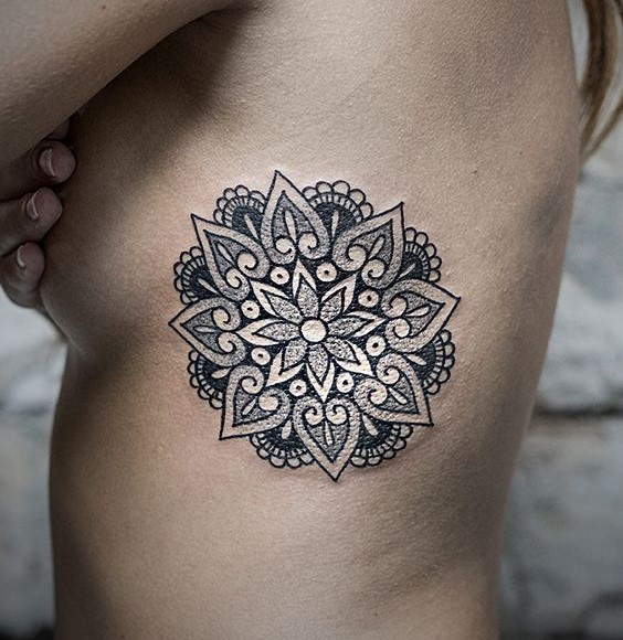 blakc and white mandala tattoo