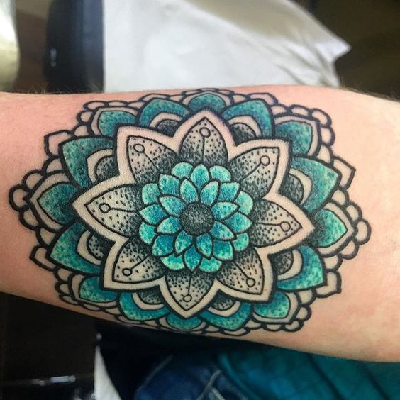 blue and green mandala tattoo