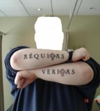 Veritas And Aequitas Tattooed On Forearms, The Words Imply Truth And Justice