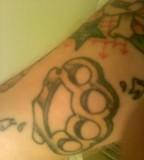 Brass Knuckle Tattoo on Calf