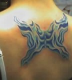 Kickass Butterfly Tattoo for Upper Back