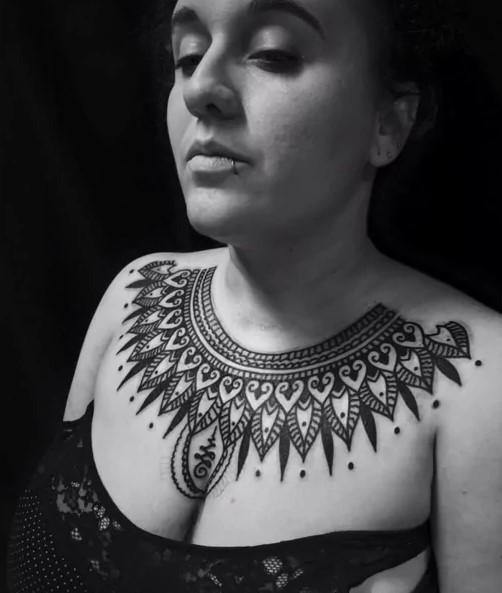 chest mehndi inspired tattoos for women