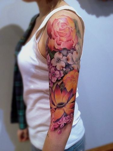 colorful upper arm sleeve flower tattoo